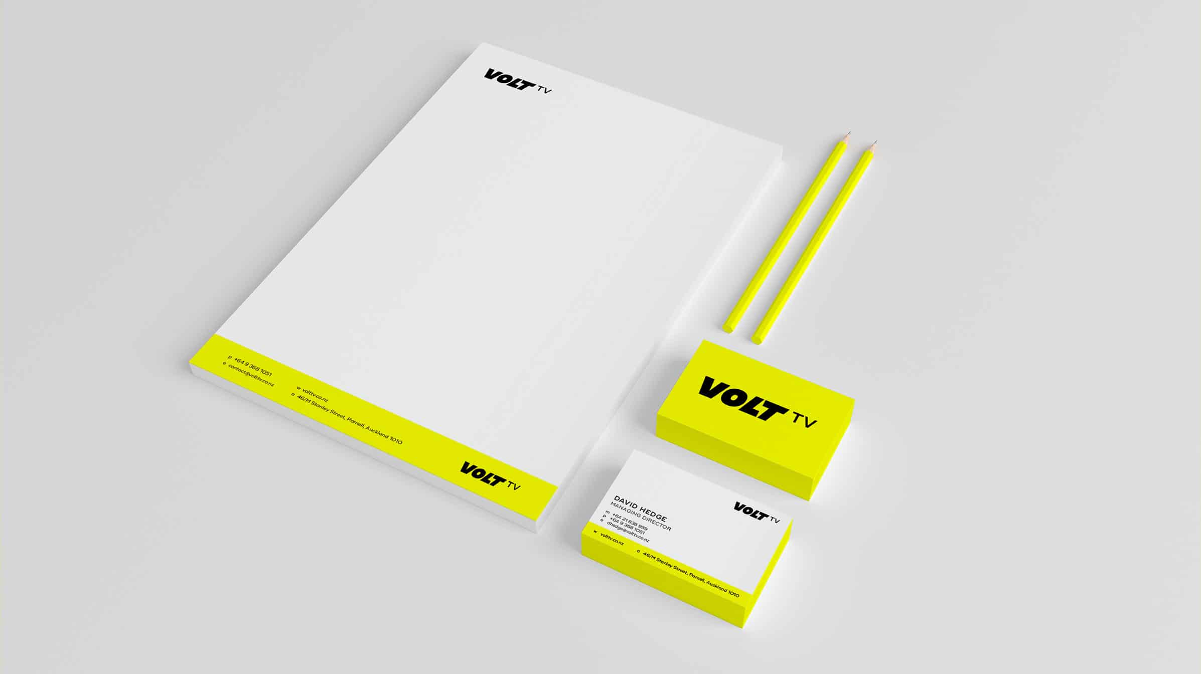Graphic designer creates bright letterhead and business card
