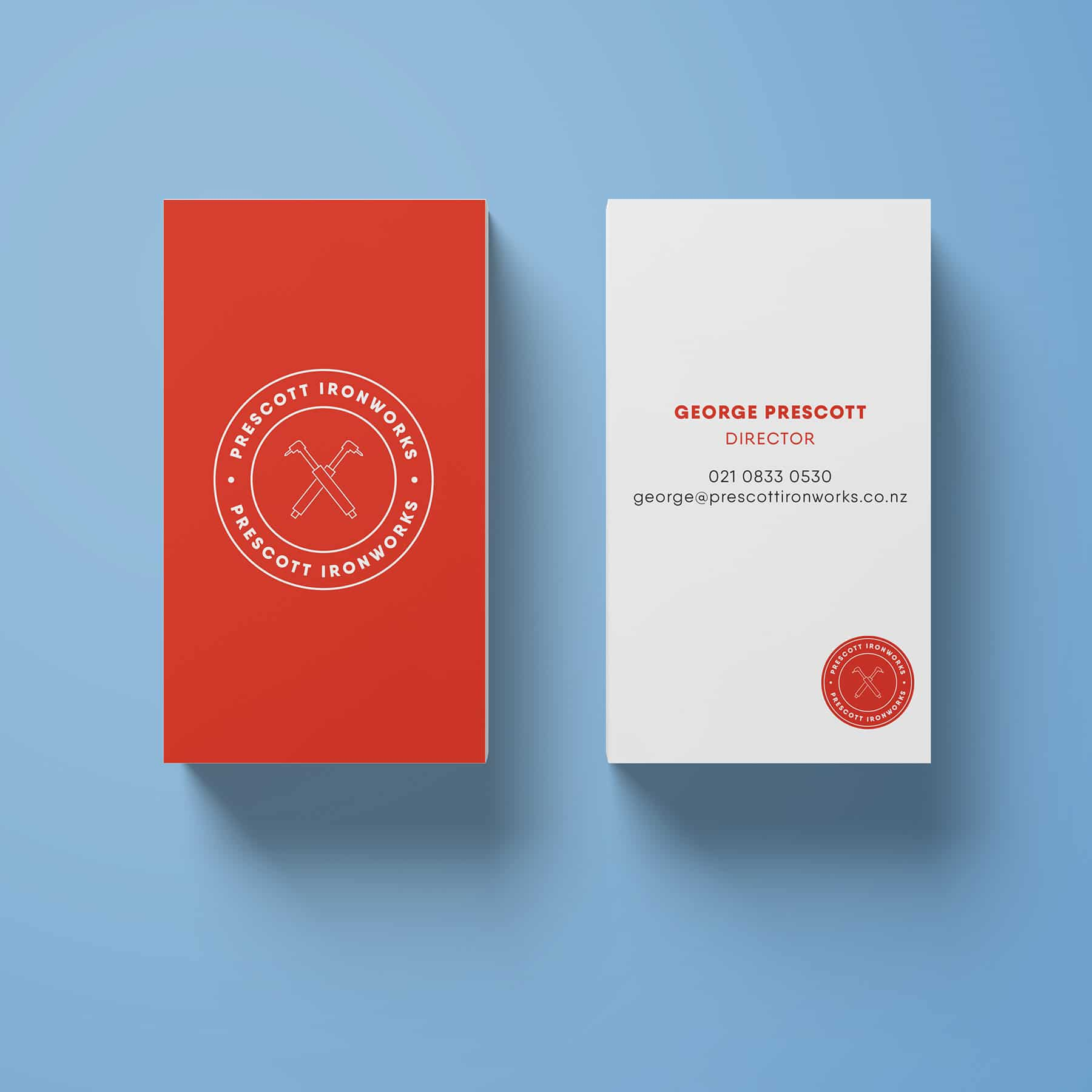 Graphic design company in NZ work on some white and red business cards