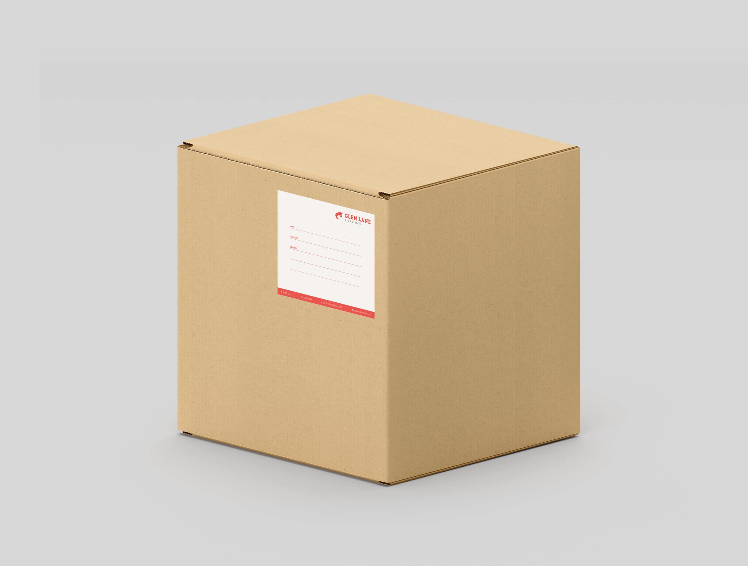 Custom made white and red address label on cardboard box