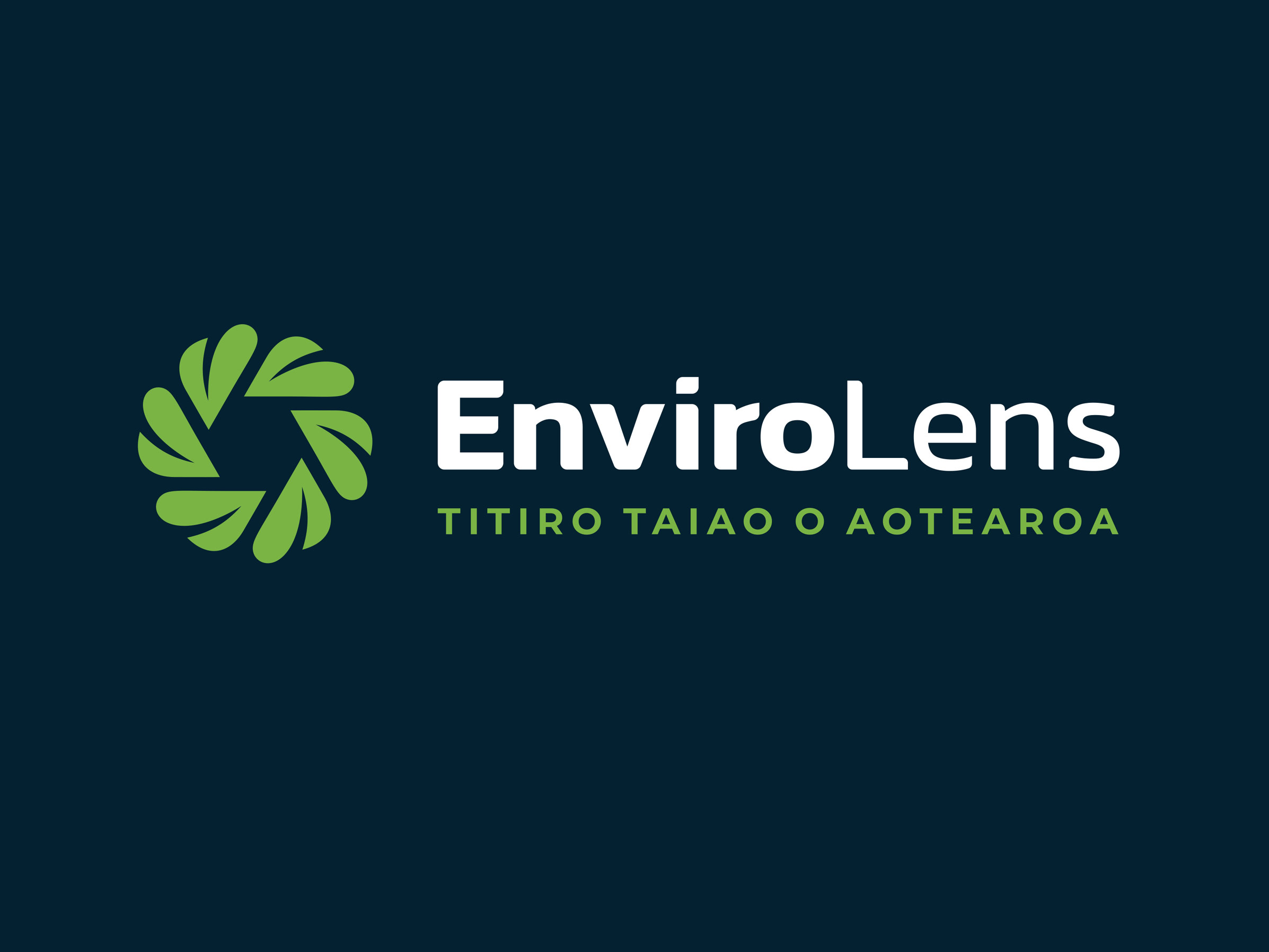 Leaf and lens logo design in green and navy blue
